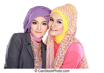Portrait of two beautiful muslim woman having fun together...