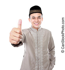 smiling asian muslim man showing thumb up isolated over...