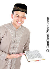 muslim man holding quran isolated over white background