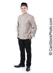 smiling asian muslim man - portrait of smiling asian muslim...