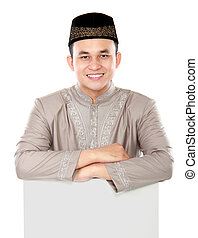 smiling asian muslim man holding blank board - smiling asian...