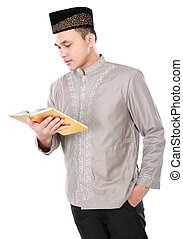 muslim man holding and reading quran isolated over white...