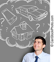 business man dreaming of buying house, car or gadget -...
