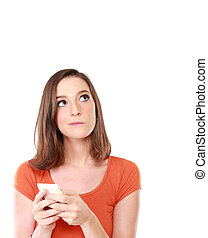 girl with mobile phone looking up to blank space - portrait...