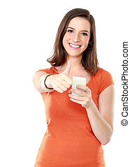 young woman smiling using mobile phone - portrait of young...