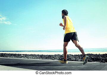 Man running on the beach
