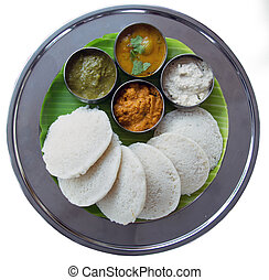 Idli and sambar isolated on white background. South Indian...