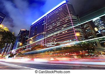 Car light through city at night