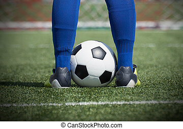 Soccer player's feet on the ball