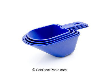 Measuring cups - Stack of blue platic measuring cups on...