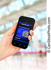 hand holding mobile phone with mobile boarding pass on...