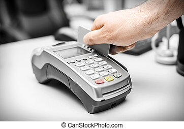 Bank terminal - Human hand holding plastic card in payme