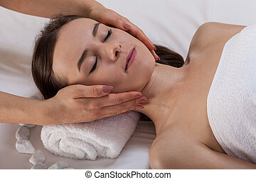 Woman during a beauty treatment at spa - Close-up of a woman...