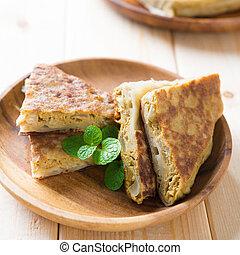 Pan fried stuffed bread murtabak