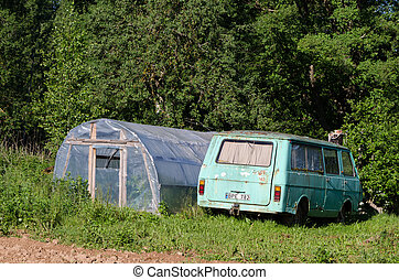 greenhouse and old mini bus in garden meadow - greenhouse...