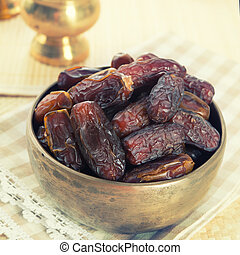 Kurma in metal bowl - Dried date palm fruits or kurma,...