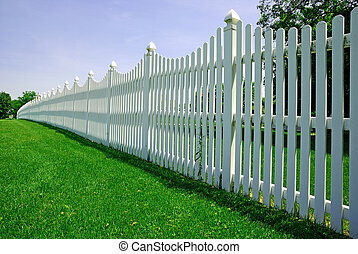 white fence along with the lawn ground