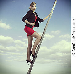 business woman on ladder - ambitious business woman with...