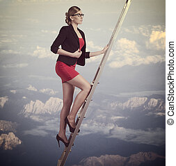 business woman climbing - concept portrait of young business...