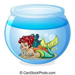 An aquarium with a mermaid