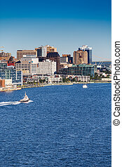 Tugboat Sailing Past Halifax Vertical - A tugboat sailing...