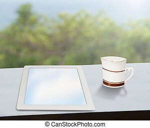 tablet with coffee mug on window side table