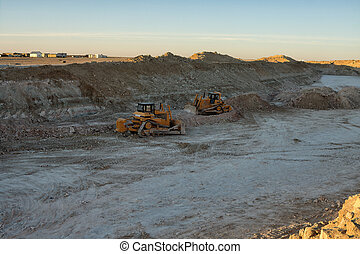 Bulldozers. - Bulldozers at the bottom of the quarry.