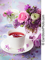 Spring flowers - Beautiful spring flowers in vase and cup of...