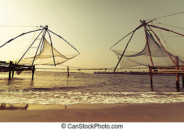 Sunset at tropical beach with chinese fishing nets - Sunset...