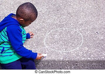 Chalk Drawing - Image of African American Child drawing with...