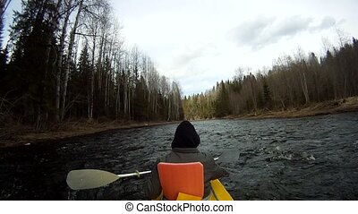 rafting on a kayak in the winter river  with sound