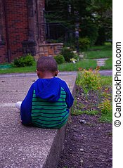 Child feeling alone - Image of African American boy...