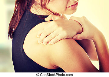Back pain concept. - Young woman with pain in her back.