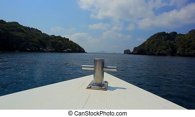 Sailing speedboat to the islands in ocean with views of...