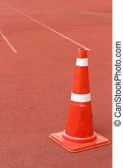 Traffic cone on the rubber flooring - A Traffic cone on the...