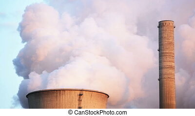 Steaming Cooling Tower - Time lapse sequence of a cooling...