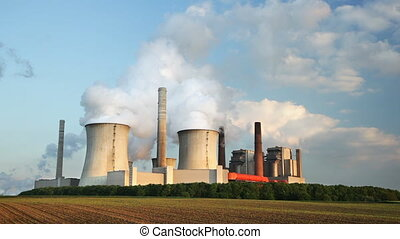 Power Station In The Evening - A coal-fired power station in...