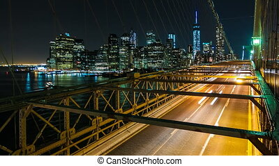 Brooklyn Bridge, New York City - Night Traffic on the...