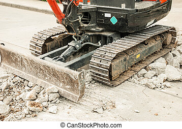 Mini Excavator - The image of Mini-Excavator at workplace