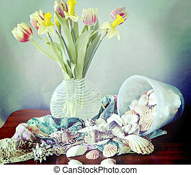 Still life,spring flowers, shells and silk scarves