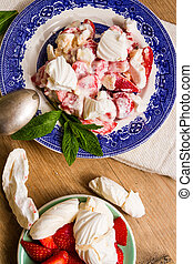 Meringue, cream and strawberries dessert - Typical English...