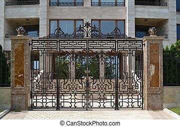 Iron gate - classic iron gate with building