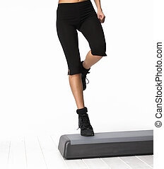 Step Aerobics - Pretty girl on step aerobics isolated on...