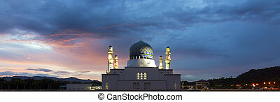 Kota Kinabalu mosque with dramatic and colorful clouds at...
