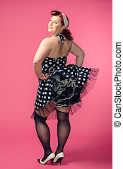 Pin-up woman - Mature pin-up woman wearing 50s style dress,...