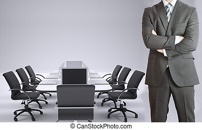 Businessman and conference table with laptops - Businessman...