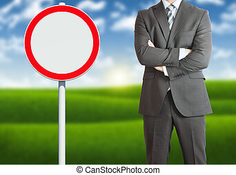 Businessman with road sign