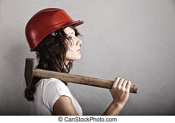 Sexy girl in safety helmet holding hammer tool - Sex...