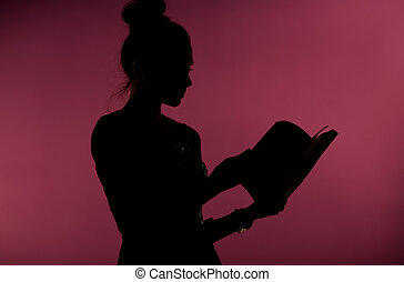 Woman reading an interesting book - Lady reading an...