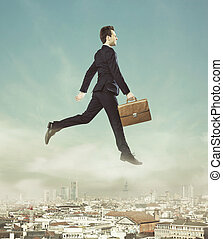 Conceptual photo of flying businessman - Conceptual photo of...